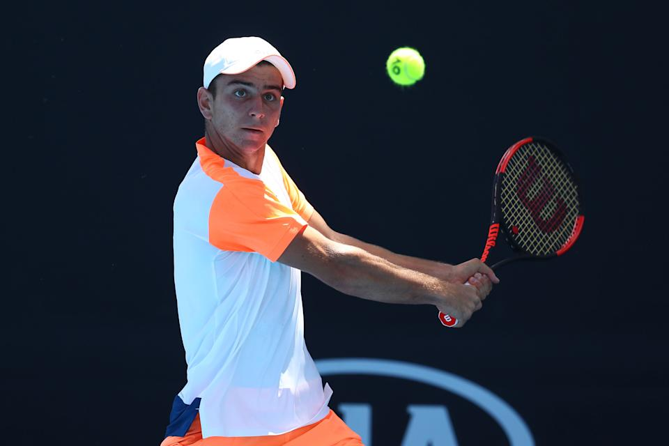 MELBOURNE, AUSTRALIA - JANUARY 21:  Ergi Kirkin of Turkey plays a backhand in his first round match against Olukayode Alafia Damina Ayeni of the United States during the Australian Open 2017 Junior Championships at Melbourne Park on January 21, 2017 in Melbourne, Australia.  (Photo by Ryan Pierse/Getty Images)