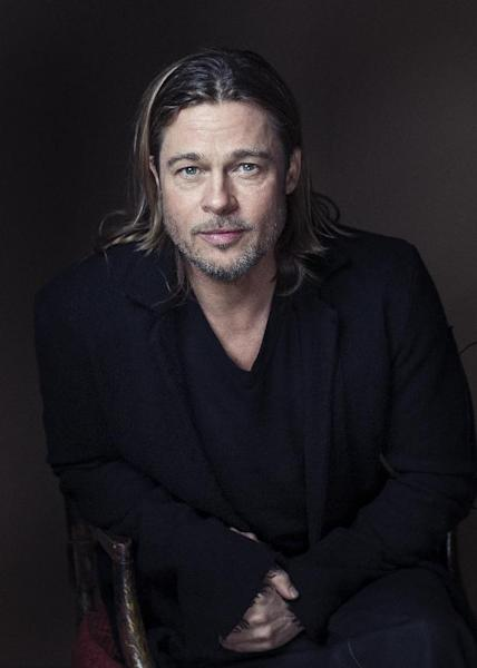 """Brad Pitt poses for a portrait to promote his film, """"Killing Them Softly,"""" on Monday, Nov. 26, 2012 in New York. (Photo by Victoria Will/Invision/AP)"""