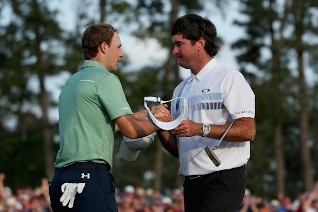 AUGUSTA, GA - APRIL 13: Bubba Watson of the United States shakes hands with Jordan Spieth on the 18th green after Watson won the 2014 Masters Tournament by a three-stroke margin at Augusta National Golf Club on April 13, 2014 in Augusta, Georgia. (Photo by Andrew Redington/Getty Images)