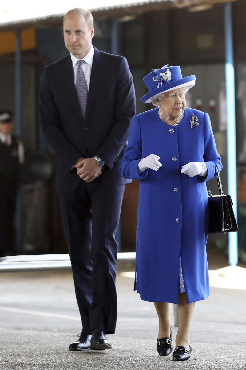 LONDON, ENGLAND - JUNE 16: Queen Elizabeth II and Prince William, Duke of Cambridge visit the scene of the Grenfell Tower fire on June 16, 2017 in London, England. 17 people have been confirmed dead and dozens still missing, after the 24 storey residential Grenfell Tower block in Latimer Road was engulfed in flames in the early hours of June 14. Emergency services will spend a third day searching through the building for bodies. Police have said that some victims may never be identified. (Photo by Dan Kitwood/Getty Images)