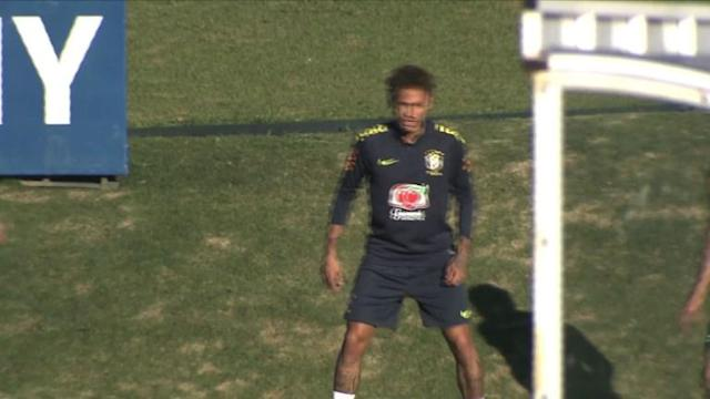 The Brazilian football team, including star Neymar, holds its first training session in preparation for the World Cup.