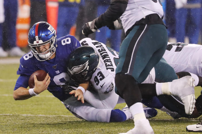 New York Giants quarterback Daniel Jones (8) is sacked by Philadelphia Eagles defensive tackle Timmy Jernigan (93) in the second half of an NFL football game, Sunday, Dec. 29, 2019, in East Rutherford, N.J. (AP Photo/Seth Wenig)
