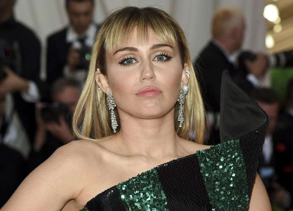"""Miley Cyrus attends The Metropolitan Museum of Art's Costume Institute benefit gala celebrating the opening of the """"Camp: Notes on Fashion"""" exhibition on Monday, May 6, 2019, in New York. (Photo by Evan Agostini/Invision/AP)"""