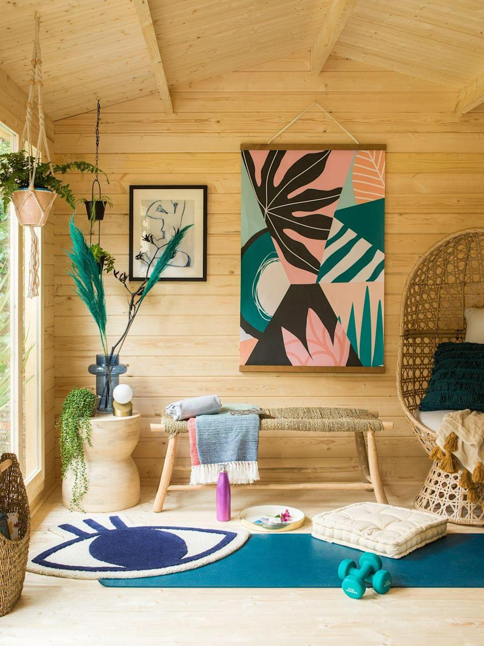 <p>Health and fitness was a key consideration for AJ when designing this space. The self-care corner is equipped with a comfy yoga mat, a couple of weights, blankets and some cushions. </p>
