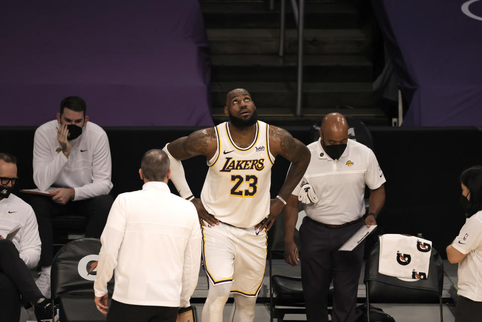 LOS ANGELES, CALIFORNIA - MARCH 20: LeBron James #23 of the Los Angeles Lakers reacts to an apparent injury during the second period of a game against the Atlanta Hawks at Staples Center on March 20, 2021 in Los Angeles, California. NOTE TO USER: User expressly acknowledges and agrees that, by downloading and or using this photograph, User is consenting to the terms and conditions of the Getty Images License Agreement. (Photo by Michael Owens/Getty Images)