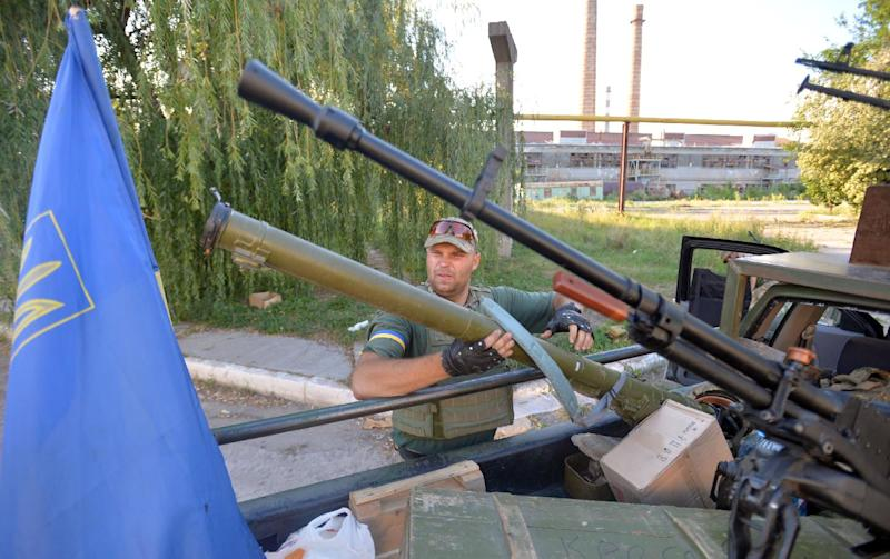 A member of the pro-Ukraine Donbass Battalion holds a rocket propelled grenade launcher seized from pro-Russians, while patroling the outskirts of the eastern Ukrainian city of Lysychansk on July 26, 2014
