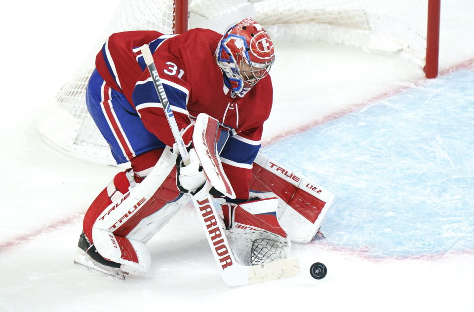Montreal Canadiens goaltender Carey Price clears the puck during the first period of an NHL Stanley Cup playoff hockey game in Montreal, Sunday, June 6, 2021. (Paul Chiasson/The Canadian Press via AP)