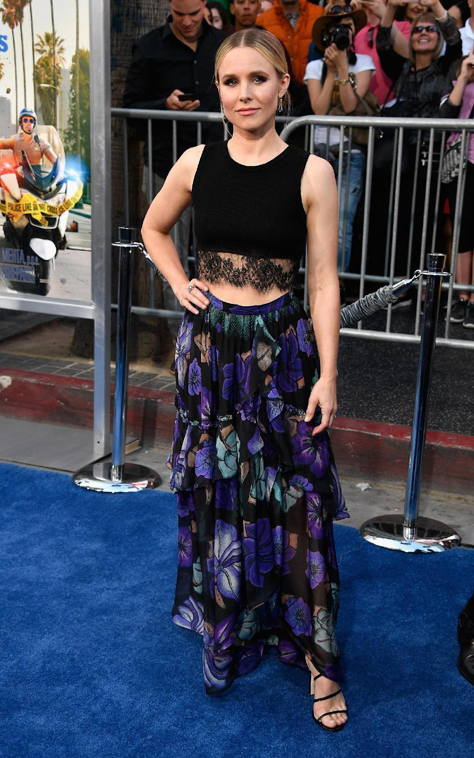<p>Kristen was summery perfection in a lacy crop top and floral maxi skirt.<br><i>[Photo: Getty]</i> </p>