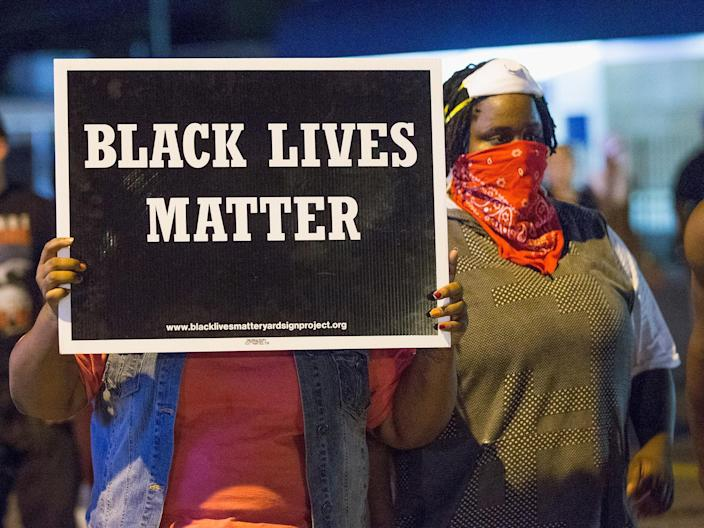 Black Lives Matter protesters in Ferguson in 2015 on the anniversary of Michael Brown's death: Getty Images