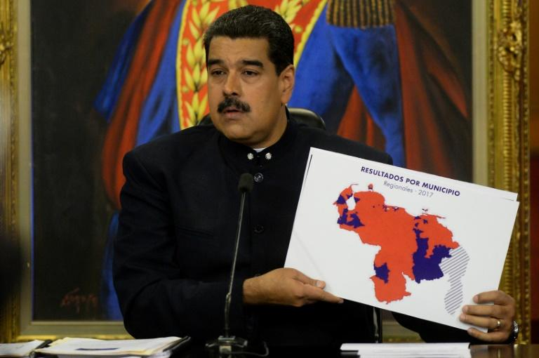 Venezuela's President Nicolas Maduro is celebrating his party's  victory in regional elections but the opposition reject the results and demand an audit