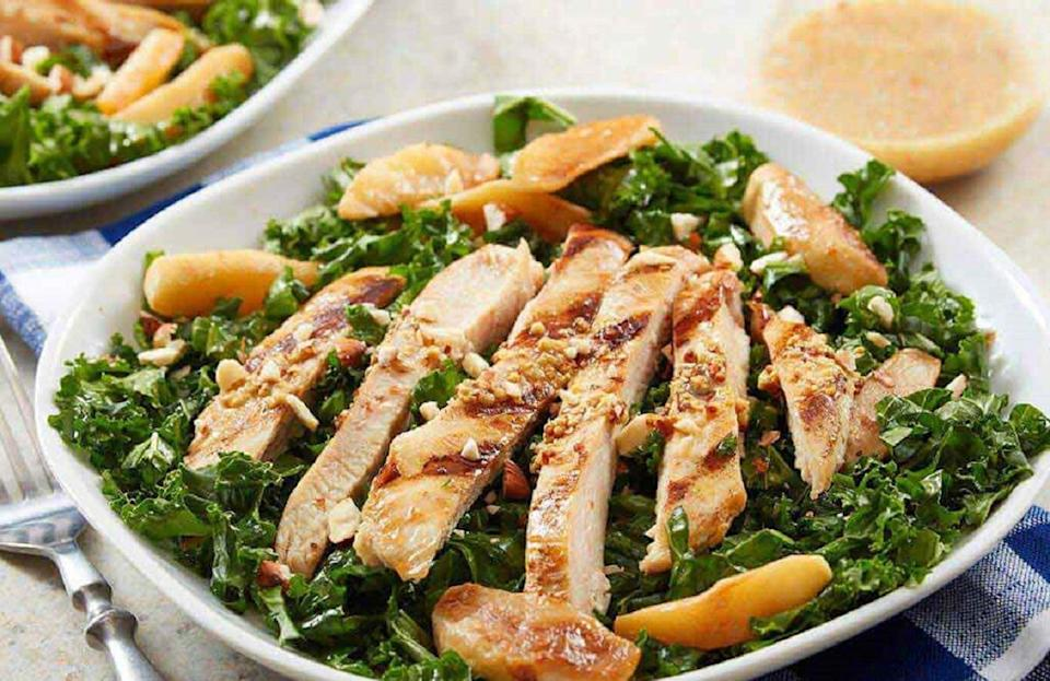 """<p>The secret to a good kale salad is to massage the leaves with oil and salt before tossing it with the rest of your favorite fixings. Not only is this kale salad packed with sweet and savory flavors like apple cider glazed chicken and green apples, but it also has plenty of <a href=""""https://www.thedailymeal.com/healthy-eating/foods-gut-health?referrer=yahoo&category=beauty_food&include_utm=1&utm_medium=referral&utm_source=yahoo&utm_campaign=feed"""" rel=""""nofollow noopener"""" target=""""_blank"""" data-ylk=""""slk:gut-healthy foods"""" class=""""link rapid-noclick-resp"""">gut-healthy foods</a>.</p> <p><a href=""""https://www.thedailymeal.com/recipes/hard-apple-cider-glazed-chicken-kale-salad-recipe?referrer=yahoo&category=beauty_food&include_utm=1&utm_medium=referral&utm_source=yahoo&utm_campaign=feed"""" rel=""""nofollow noopener"""" target=""""_blank"""" data-ylk=""""slk:For the Hard Apple Cider-Glazed Chicken Kale Salad recipe, click here."""" class=""""link rapid-noclick-resp"""">For the Hard Apple Cider-Glazed Chicken Kale Salad recipe, click here.</a></p>"""
