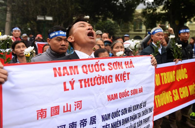 An activist shouts anti-China slogans during a rally in 2016 marking the anniversary of a 1974 naval battle between China and then-South Vietnamese troops over the disputed Paracel Islands in the South China Sea