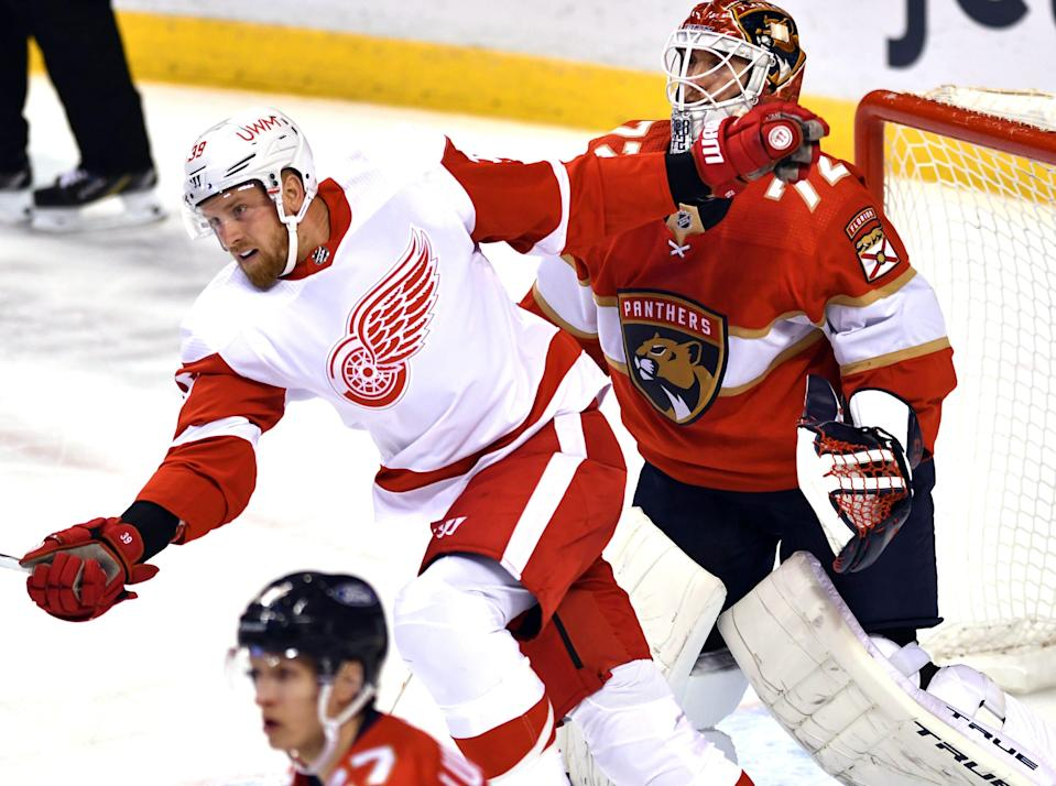 Detroit Red Wings right wing Anthony Mantha crosses the path of Florida Panthers goaltender Sergei Bobrovsky during the first period Tuesday, Feb. 9, 2021, in Sunrise, Fla.