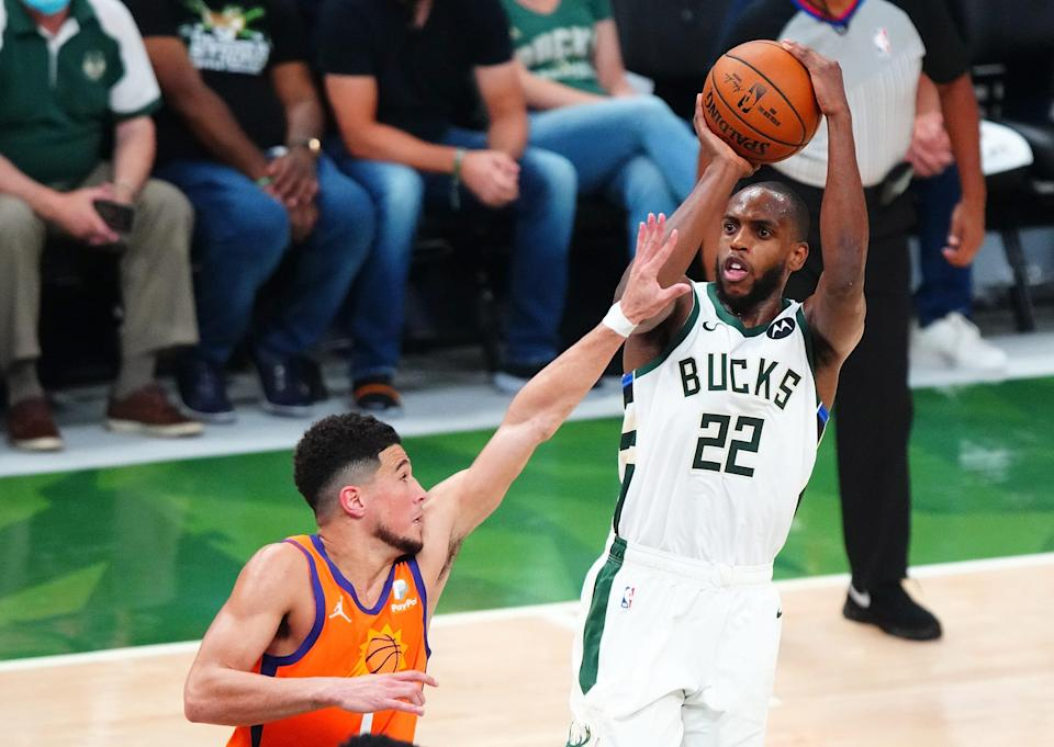 Khris Middleton set a playoff career-high with 40 points to help the Bucks overcome 42 from Devin Booker.