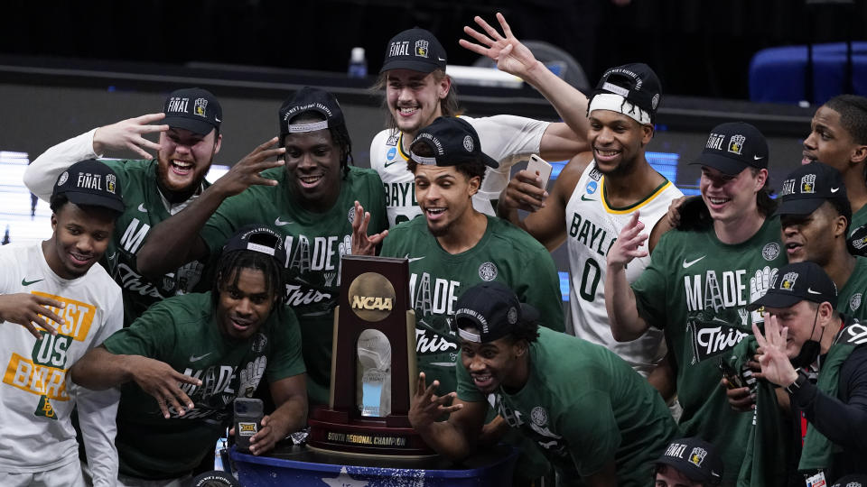 Baylor players celebrate after an Elite 8 game against Arkansas in the NCAA men's college basketball tournament at Lucas Oil Stadium, Tuesday, March 30, 2021, in Indianapolis. Baylor won 81-72. (AP Photo/Darron Cummings)