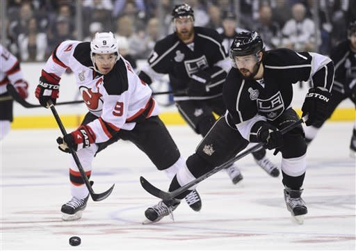New Jersey Devils defenseman Andy Greene (6) and Los Angeles Kings defenseman Drew Doughty (8) race after the puck in the first period during Game 6 of the NHL hockey Stanley Cup finals,Monday, June 11, 2012, in Los Angeles. (AP Photo/Mark J. Terrill)