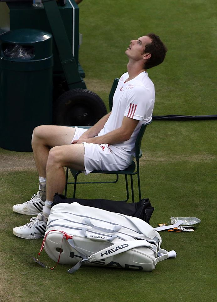 LONDON, ENGLAND - JULY 08:  Andy Murray of Great Britain reacts after being defeated in his Gentlemen's Singles final match against Roger Federer of Switzerland on day thirteen of the Wimbledon Lawn Tennis Championships at the All England Lawn Tennis and Croquet Club on July 8, 2012 in London, England.  (Photo by Paul Gilham/Getty Images)