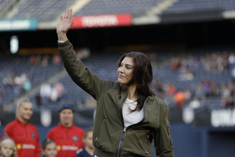 Former United States goalkeeper Hope Solo reacts during ceremony before an international friendly soccer match against Denmark Sunday, Jan. 21, 2018, in San Diego. Solo appeared in 202 games for the national team, most for any goalkeeper in U.S. history. (AP Photo/Gregory Bull)