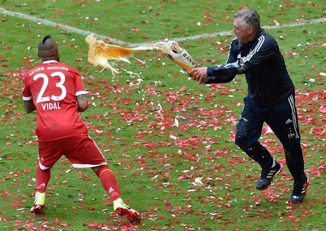 Carlo Ancelotti (R) has always had a playful side to his nature which will serve him well on Merseyside (AFP Photo/Guenter SCHIFFMANN)