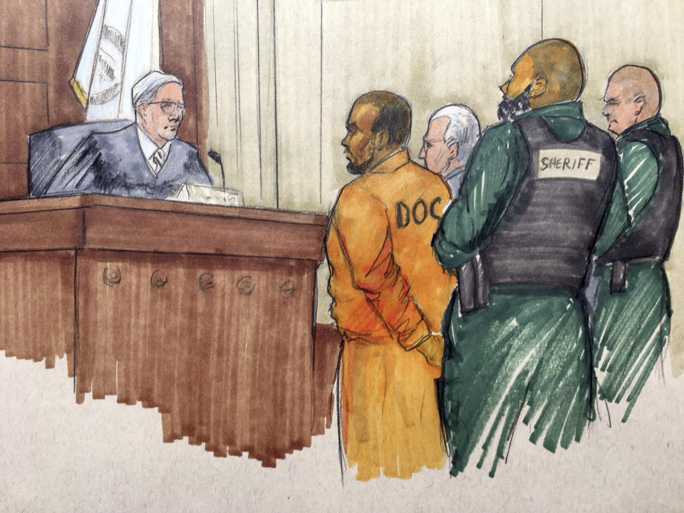In this courtroom sketch, R&B singer R. Kelly appears before Cook County Associate Judge Lawrence Flood with his attorney Steve Greenberg Monday, Feb. 25, 2019. (Tom Gianni via AP)