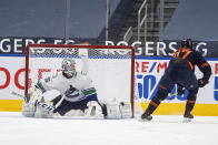 Edmonton Oilers' Connor McDavid (97) is stopped by Vancouver Canucks goalie Thatcher Demko (35) during the third period of an NHL hockey game Thursday, May, 6, 2021, in Edmonton, Alberta. (Jason Franson/The Canadian Press via AP)