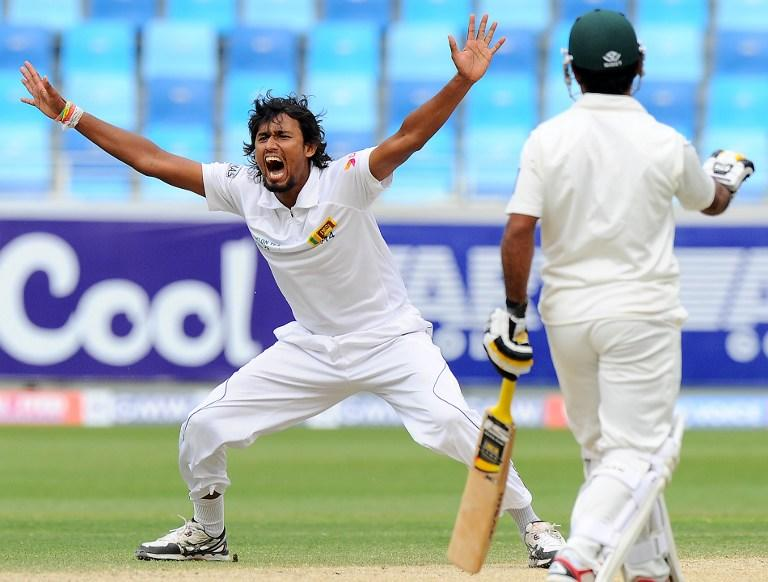 Sri Lankan bowler Suranga Lakmal (L) unsuccessfully appeals for a Leg Before Wicket (LBW) decision against Pakistan batsman Misbah-ul-Haq during the fourth day of the second cricket Test match between Pakistan and Sri Lanka at the Dubai International Cricket Stadium in Dubai on January 11, 2014.  AFP PHOTO/Ishara S. KODIKARA
