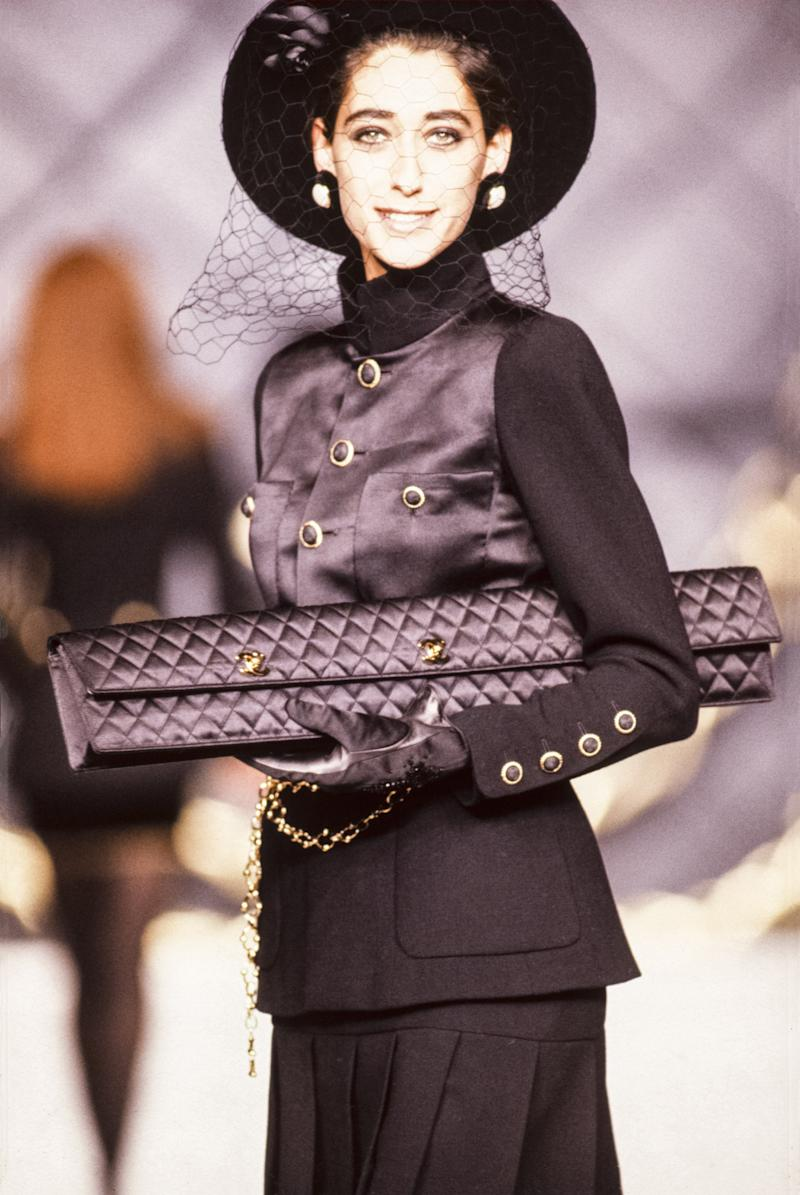 Several years before Fendi debuted the baguette bag, Lagerfeld showcased an early version of the oblong object, making the case for redubbing the Fendi version the demi-baguette.
