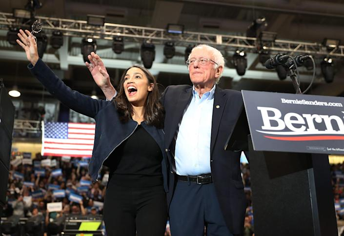 U.S. Rep. Alexandria Ocasio-Cortez (D-N.Y) and Democratic presidential candidate Sen. Bernie Sanders (I-VT) stand together during his campaign event at the Whittemore Center Arena on Feb. 10, 2020 in Durham, N.H.