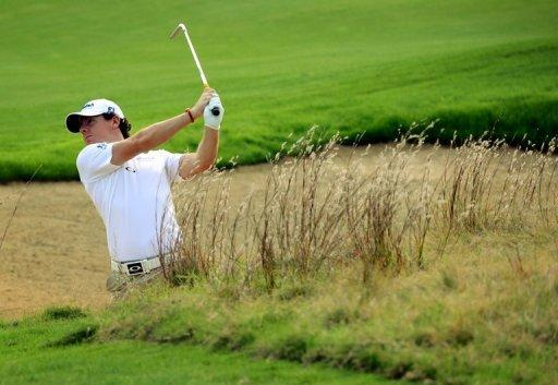 Rory McIlroy plays a shot at the Lake Malaren Golf Club in Shanghai on October 24, 2012