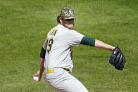Oakland Athletics' pitcher Cole Irvin throws against the Minnesota Twins in the first inning of a baseball game, Saturday, May 15, 2021, in Minneapolis. (AP Photo/Jim Mone)