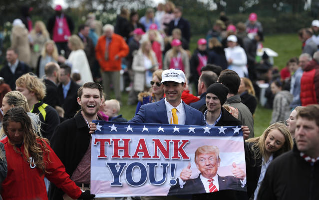 "<p>Supporters of U.S. President Donald Trump hold a ""Thank You!"" banner at the annual White House Easter Egg Roll on the South Lawn of the White House in Washington, U.S., April 2, 2018. (Photo: Carlos Barria/Reuters) </p>"