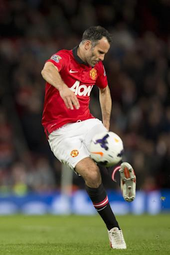 Manchester United's interim manager Ryan Giggs takes a free kick during his team's English Premier League soccer match against Hull City, at Old Trafford Stadium, Manchester, England, Tuesday May 6, 2014. (AP Photo/Jon Super)