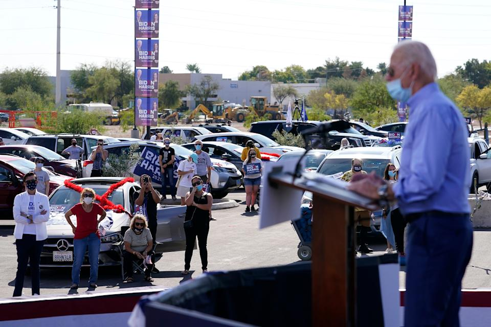 Supporters watch as Democratic presidential nominee Joe Biden speaks at a Las Vegas drive-In campaign event on Oct. 9. (Photo: ASSOCIATED PRESS)