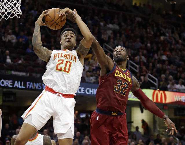 "<a class=""link rapid-noclick-resp"" href=""/olympics/rio-2016/a/1211578/"" data-ylk=""slk:John Collins"">John Collins</a> finished with 12 points, 13 rebounds and assaulted the rim in Atlanta's win over Cleveland. (AP Photo/Tony Dejak)"