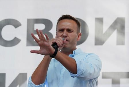 Russian opposition leader Alexei Navalny addresses demonstrators during a rally in Moscow