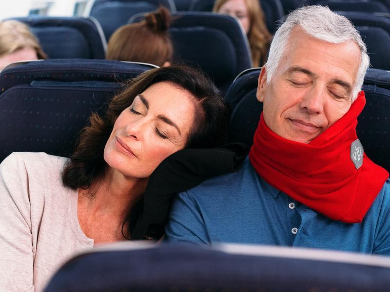 Sleep on planes in comfort with the Trtl travel pillow. (Photo: Trtl)