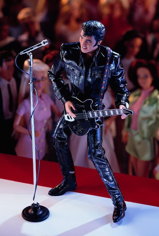 "<div class=""caption-credit""> Photo by: barbiecollector.com</div><b>Elvis Presley doll, released in 1998 for $49.98</b> <br> This was created in honor of the 30th anniversary of Elvis' 1968 TV special. Guitar and sideburns are included, but you'll have to provide your own screaming audience of Barbies."