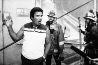 Actor William Shanter, talks with persons outside the set of Star Trek III Aug. 25, 1983, on the lot of Paramount Studios in Los Angeles, where a major fire burned several sets. (AP PhotoDouglas /Pizac)