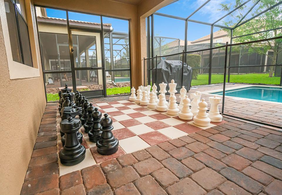 PIC BY @LOMA HOMES / CATERS NEWS AGENCY (PICTURED- Giant chess board as seen the The Chamber Of Secrets ) - Harry Potter fans looking for a first post-lockdown trip can put this place at the top of their list - a night in a Hogwarts- themed Airbnb. The eight-bedroom home, called  Wizardy's Way is based in Florida, US, near the Universal Orlando Resort. There are rooms based on the four houses Gryffindor, Hufflepuff, Ravenclaw, and Slytherin and each bathroom has its own Harry Potter theme, from Hedwig and the  Ministry of Magic to Dobby, and Sirius Black. One of the bedrooms  features an interactive car-shaped bed which is inspired by the scene where Harry and Ron get stuck in the Willow Tree of the second part of the film series. - SEE CATERS COPY