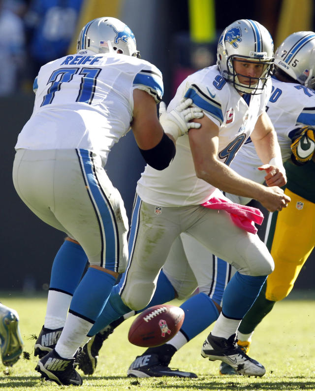 Detroit Lions' Matthew Stafford (9) goes after his fumble in front of teammate Riley Reiff (71) during the second half of an NFL football game against the Green Bay Packers Sunday, Oct. 6, 2013, in Green Bay, Wis. The Lions recovered the ball. (AP Photo/Mike Roemer)