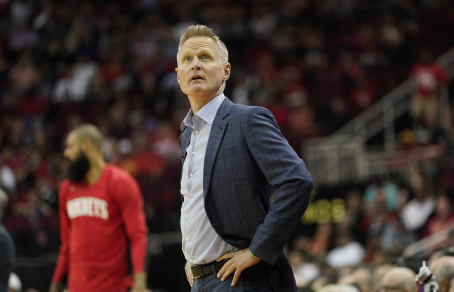 Golden State Warriors coach Steve Kerr looks up at the scoreboard during the first half of an NBA basketball game against the Houston Rockets Wednesday, Nov. 6, 2019, in Houston. (AP Photo/David J. Phillip)