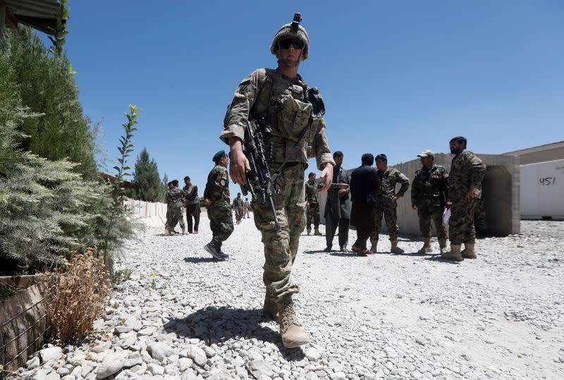 FILE PHOTO: An U.S. soldier keeps watch at an Afghan National Army (ANA) base in Logar province, Afghanistan