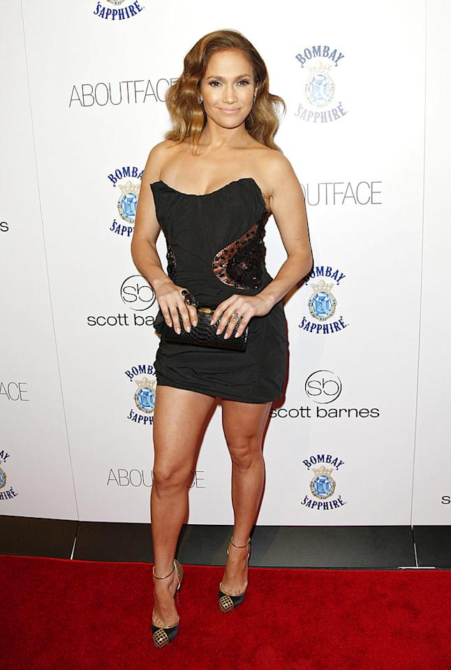 """Jennifer Lopez popped a pose in sexy Louis Vuitton Spring 2009 strapless LBD at the Hotel Gansevoort in New York on Wednesday night. Lopez graces the cover of her friend Scott Barnes' new beauty book, <i>About Face</i>. Brian Ach/<a href=""""http://www.gettyimages.com/"""" target=""""new"""">GettyImages.com</a> - January 20, 2010"""