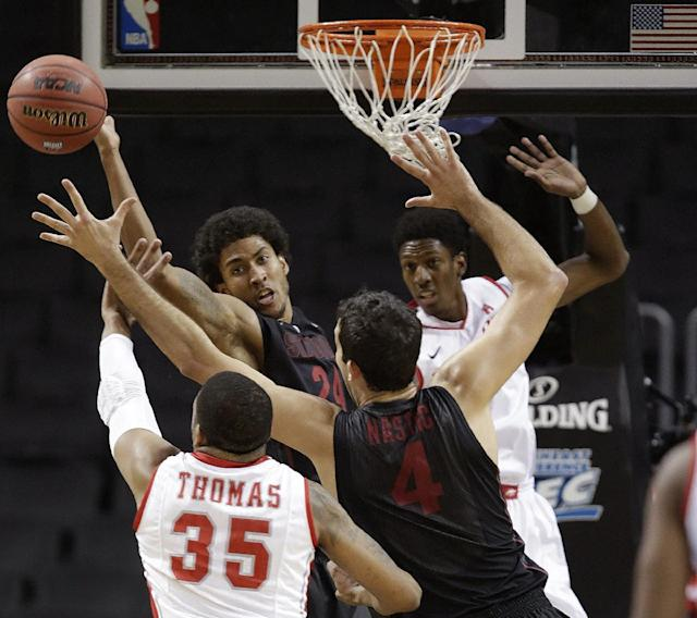 Stanford forward Josh Huestis (24) tries to tip a rebound to Stanford center Stefan Nastic (4) as Houston forward TaShawn Thomas (35) reaches for the ball during the first half of an NCAA college basketball game, part of the Legends Classic, Monday, Nov. 25, 2013, in New York. (AP Photo/Kathy Willens)