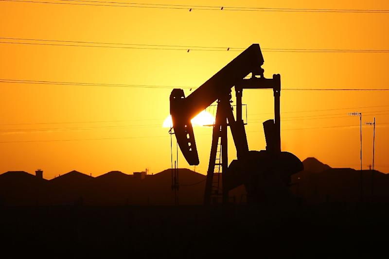 Oil prices are up more than one percent Friday, a day after being hammered by concerns about the impact of the trade war on demand (AFP Photo/SPENCER PLATT)