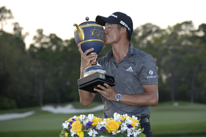 Collin Morikawa kisses the championship trophy after winning the Workday Championship golf tournament Sunday, Feb. 28, 2021, in Bradenton, Fla. (AP Photo/Phelan M. Ebenhack)