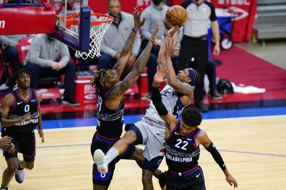 Washington Wizards' Bradley Beal center, tries to get a shot past Philadelphia 76ers' Matisse Thybulle, right, and Dwight Howard during the second half of Game 2 in a first-round NBA basketball playoff series, Wednesday, May 26, 2021, in Philadelphia. (AP Photo/Matt Slocum)