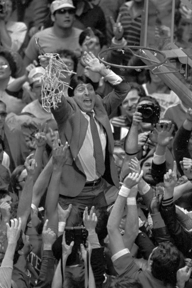 FILE - In this April 4, 1983 file photo, North Carolina State coach Jim Valvano holds the net aloft after his team defeated Houston 54-52 for the national championship at the Final Four NCAA college basketball tournament in Albuquerque, N.M. (AP Photo/Leonard Ignelzi, File)