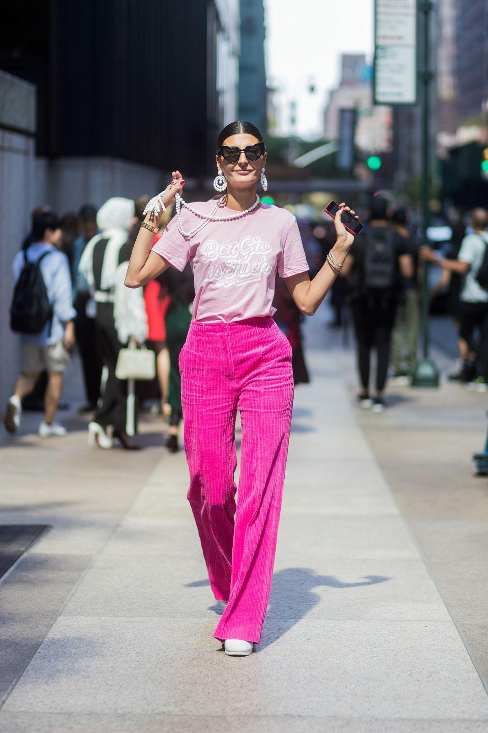<p>She gave pearls a modern appeal by wearing them with a T-shirt and wide-leg velvet trousers in September 2017.</p>