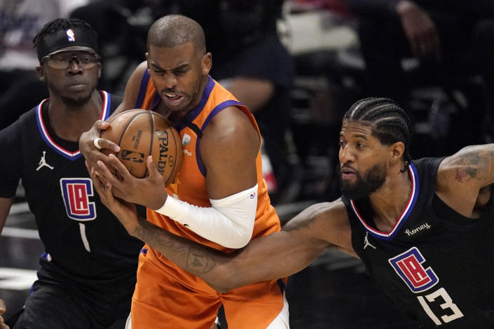 Los Angeles Clippers guard Paul George, right, reaches in on Phoenix Suns guard Chris Paul during the second half in Game 6 of the NBA basketball Western Conference Finals Wednesday, June 30, 2021, in Los Angeles. (AP Photo/Mark J. Terrill)